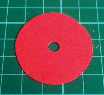 red paper disc with hole